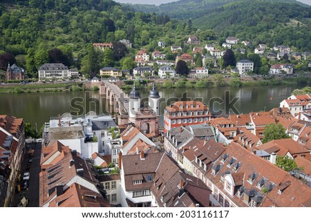 View of Heidelberg and the Old Bridge across the Neckar river in Germany from the church tower of the Heiliggeist church, church of the Holy Spirit - stock photo