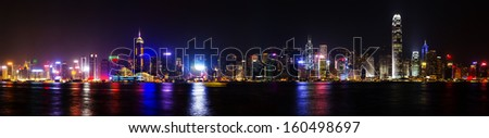 View of Hong Kong skyline shortly after sunset at Victoria Harbor  - stock photo