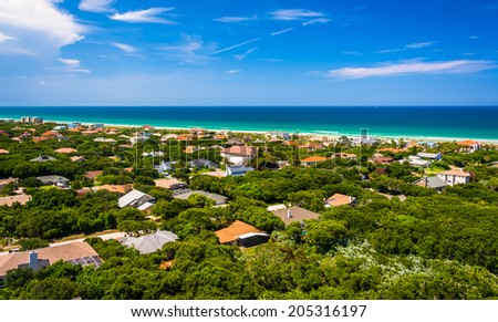 View of houses and the Atlantic Ocean from Ponce de Leon Inlet Lighthouse, Florida. - stock photo
