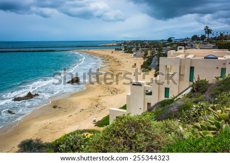 View of houses on cliffs above the Pacific Ocean from Inspiration Point in Corona del Mar, California. - stock photo