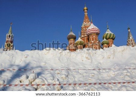 View of huge snowdrift on the background of Saint Basil's Church on the Red square in Moscow after a heavy snowfall, Russia - stock photo