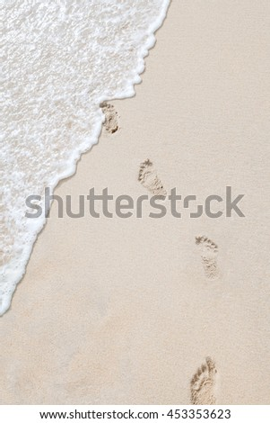 view of human steps on summer sandy beach - stock photo