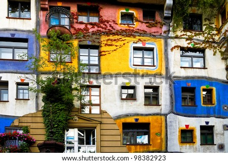 View of Hundertwasser house in Vienna, Austria. Idea and concept of Austrian artist Friedensreich Hundertwasser. Hundertwasserhaus apartment house is famous attraction Vienna, Austria - stock photo
