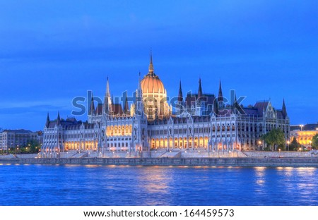 View of Hungarian parliament building in Budapest at the blue hour. HDR image using tone mapping. - stock photo