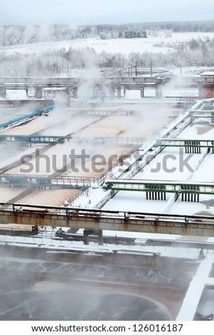 View of industrial sewage treatment plant with evaporation in winter - stock photo