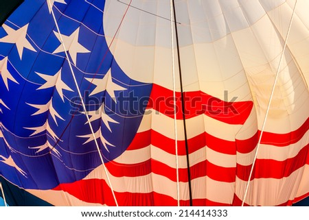 View of inside of American flag hot air balloon getting inflated before take off - stock photo