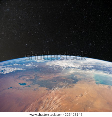 View of Iraq from space with stars above.  Elements of this image furnished by NASA.  - stock photo