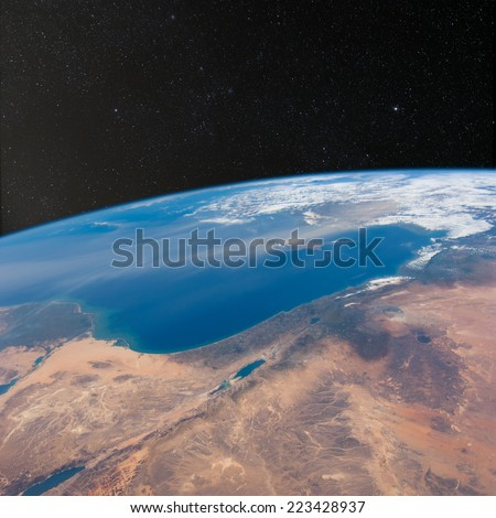 View of Israel, Jordan, Lebanon and Egypt from space with stars above.  Elements of this image furnished by NASA.  - stock photo
