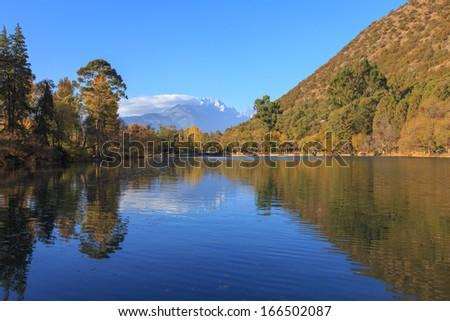 View of Jade Dragon Snow Mountain from Black Dragon Pool in Lijiang , Yunnan China - stock photo