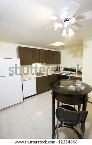 View of kitchen and small table in condominium - stock photo