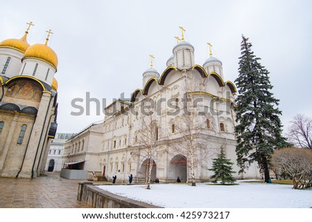 View of Kremlin palace. Arkhangelskiy and Announciation cathedrals and bell tower of Ivan the Great. The Annunciation Cathedral, Moscow, Russia. Moscow Kremlin is a popular touristic landmark. - stock photo