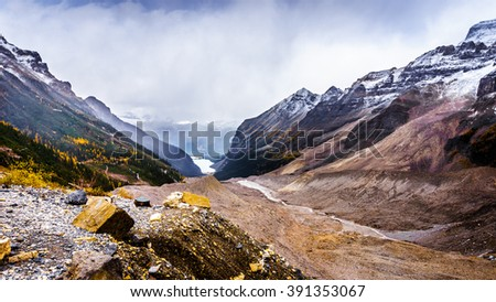 View of Lake Louise from the lateral moraine at the Plain of Six Glaciers at an elevation of 2150 meters or 7000 feet in Banff National Park in the Canadian Rocky Mountains - stock photo