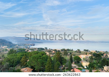 view of Lake of bracciano. The lake is a volcanic origin crater lake and the second largest lake in Lazio, Italy. - stock photo