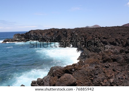 View of Lanzarote Volcanic Coast ( Canary Islands, Spain ) - stock photo