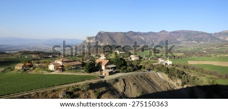 View of Lardier-and-Valenca, one of the 15 hanging villages which surround Tallard, Haute Alpes, France - stock photo
