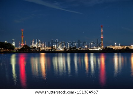 View of large refinery at night in Gdansk, Poland. - stock photo
