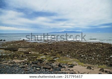 view of las americas coast with las palmas island at background, tenerife, canary islands - stock photo