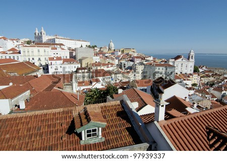 View of Lisbon wth church and river on the background - stock photo
