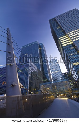 View of London's financial district in Canary Wharf over the South Quay footbridge. - stock photo