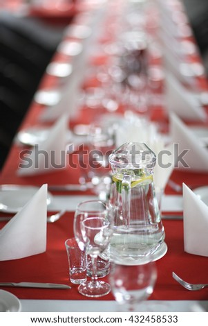 View of long table prepared for guest - stock photo