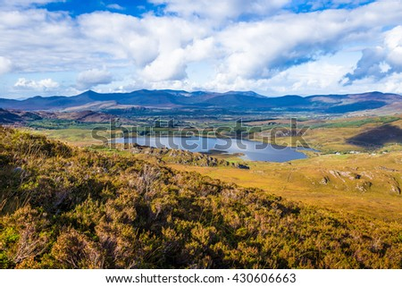 View of Lough Acoose in Ballycullane from the foothill of Macgillycuddy's Reeks mountain range in Kerry Ireland - stock photo