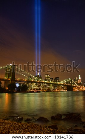 View of lower Manhattan and Brooklyn Bridge at night on September 11, 2008. - stock photo