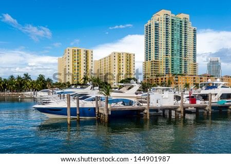 View of luxurious boats and yacht docked in a Miami Beach Marina - stock photo
