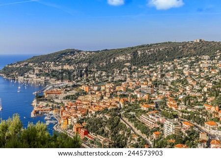 View of luxury resort Villefranche-sur-Mer and bay on French Riviera at Mediterranean Sea. Cote d'Azur. France. Villefranche-sur-Mer adjoins city of Nice to the east and 10 km south west of Monaco. - stock photo