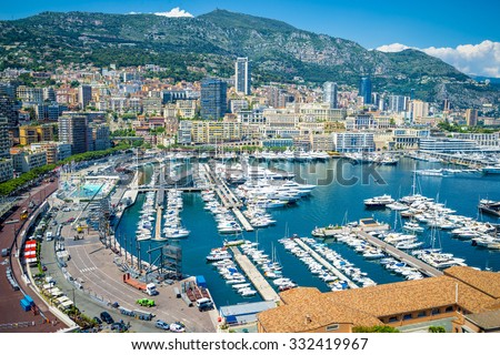 View of luxury yachts and apartments in harbor of Monaco, Cote d'Azur. - stock photo