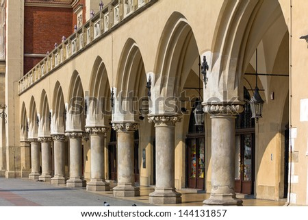 view of main market square with renaissance sukiennice in cracow in poland - stock photo