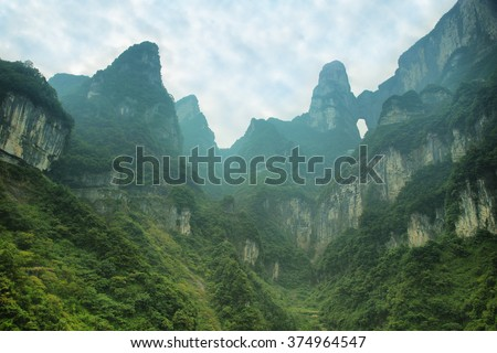 View of majestic peaks and Tianmen cave of Tianmen mountain national park, Hunan province, China - stock photo