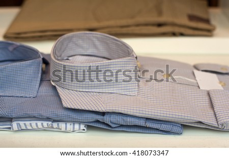 View of male shirts exposed in the clothes shop - stock photo