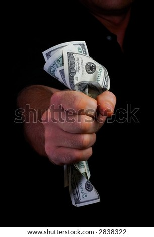 view of man's hand squeezing tightly some banknotes - stock photo