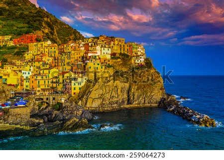 View of Manarolaat sunset, one of the five villages of the Cinque Terre on Italy mediterranean coast - stock photo