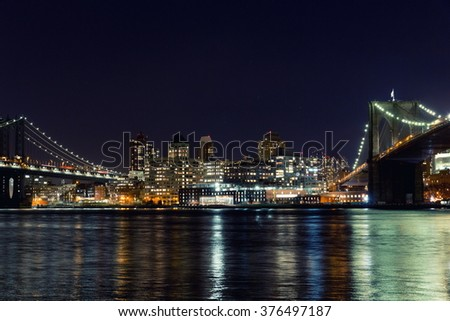 View of Manhattan bridge, Brooklyn and Manhattan bridge at night. - stock photo