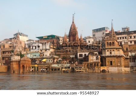 View of Manikarnika Ghat, Varanasi, India. Taken from the river after monsoon. - stock photo