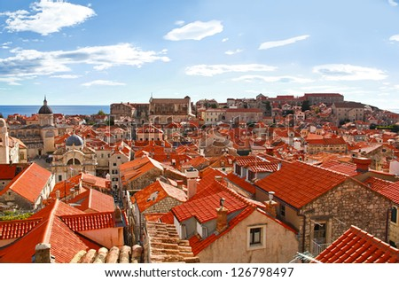 View of many landmarks of Old town in city of Dubrovnik, Croatia. Classic red tiled rooftops with Adriatic sea also are beautiful. - stock photo