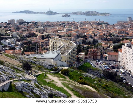 View of Marseilles city with lots of red roofs and Frioul islands in Mediterranean sea further, France - stock photo