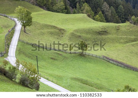 View of meadows and a road in the countryside - stock photo