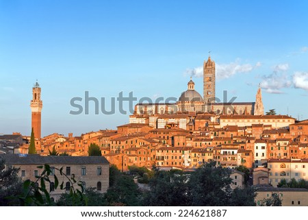 View of medieval old town of Siena, Italy at sunset - stock photo