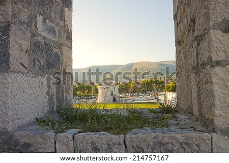 View of medieval St. Mark tower between battlements of Kamerlengo fortress in Trogir, Croatia. Both buildings were built by Venice around 1500 to defend the town from Turk invasions. - stock photo