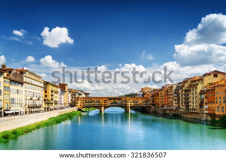 View of medieval stone bridge Ponte Vecchio and the Arno River from the Ponte Santa Trinita (Holy Trinity Bridge) in Florence, Tuscany, Italy. Florence is a popular tourist destination of Europe. - stock photo