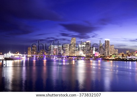 View of Miami Downtown at night time with a view on a bay, USA - stock photo