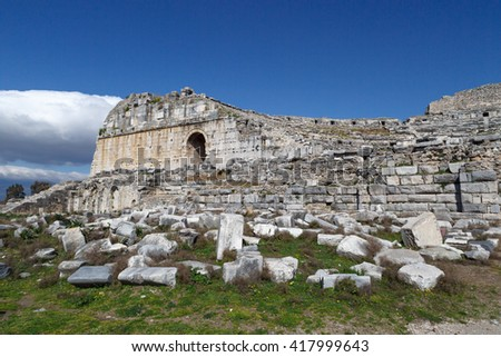 View of Miletus Ancient City ruins in Aydin, Turkey from prehistoric time, on bright blue sky background. - stock photo
