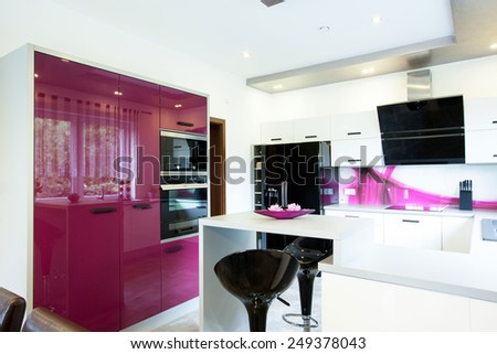 View of modern kitchen with purple elements - stock photo