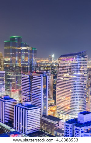 View of modern office buildings, condominium  in big city downtown at night - stock photo