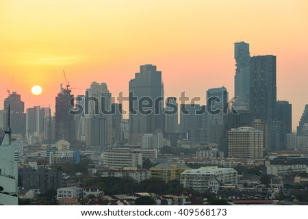 View of modern office buildings, condominium in big city downtown at sunset - stock photo