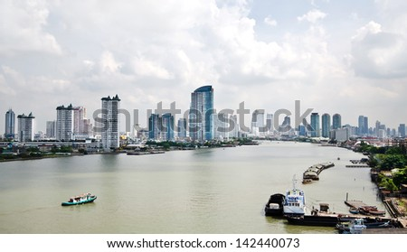 View of modern town  beside Chao Phraya River in Bangkok, Thailand - stock photo
