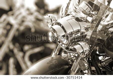 View of motorbike front head lamps. Sepia tone. Shallow DOF. - stock photo
