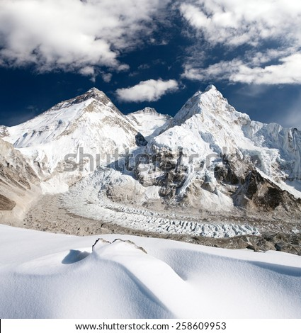 View of Mount Everest, Lhotse and Nuptse from Pumo Ri base camp - way to Mount Everest base camp - Sagarmatha national park - Nepal  - stock photo